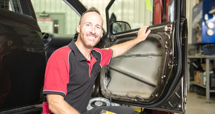 how to fix a car door dent